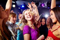 Image of happy young girls having fun at disco Stock Photos