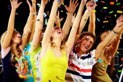 Stock Photo of photo of excited teenagers raising their arms in joy