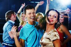 Image of pretty girl dancing on background of clubbing friends Stock Photos