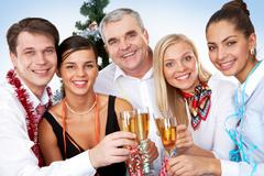 Photo of businesspeople with flutes of sparkling champagne Stock Photos