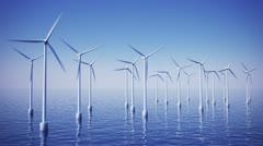 Wind turbines on ocean or sea water sustainable alternative efficient energy .  Stock Footage