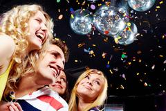Photo of emotional teenagers laughing while having great party Stock Photos