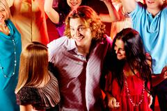 Joyful teens having nice time in night club Stock Photos