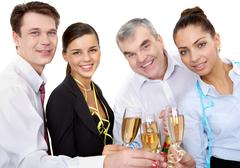 photo of businesspeople cheering up their flutes filled with sparkling champagne - stock photo
