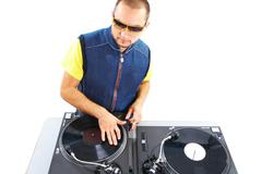 Portrait of smart deejay spinning turntables in isolation Stock Photos