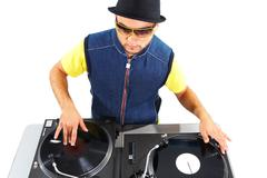 Stock Photo of portrait of modern deejay spinning turntables in isolation
