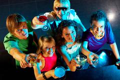 Portrait of smart young people toasting in the nightclub Stock Photos