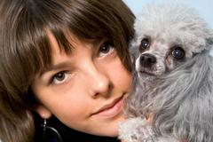 Photo of grey poodle with its master in studio Stock Photos