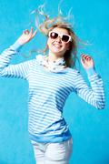 portrait of young blonde girl in stripped shirt wearing sunglasses - stock photo