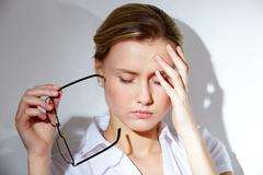 Portrait of young businesswoman having headache pains Stock Photos