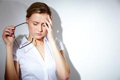 Portrait of businesswoman with strong headache Stock Photos