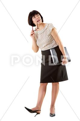 Stock photo of portrait of middle aged female in elegant clothes over white background