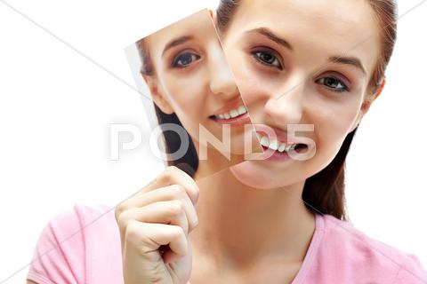 Stock photo of portrait of pretty female peeking out of her image