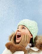 portrait of surprised girl in winter clothes - stock photo