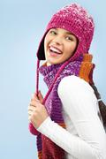 Photo of happy woman in knitted winter cap and scarf posing before camera Stock Photos