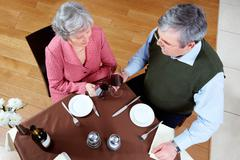 above view of senior couple at a restaurant - stock photo