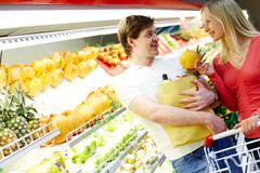 Couple in supermarket - stock photo
