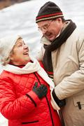 photo of old man and woman looking at each other - stock photo