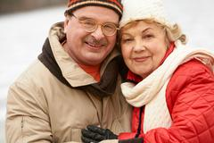 Happy aged family looking at camera during winter vacation Stock Photos