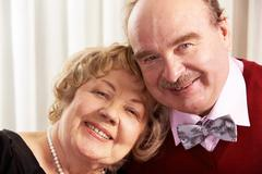 portrait of smiling mature husband and wife together - stock photo