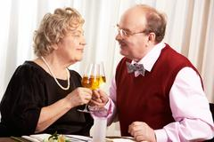 Portrait of mature husband and wife celebrating their golden wedding Stock Photos