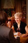 Image of happy female toasting in restaurant while looking at her sweetheart Stock Photos