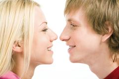 Loving couple looking at each other with smiles Stock Photos