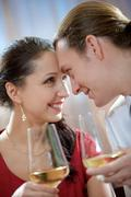image of amorous couple toasting and looking at each other - stock photo