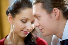 image of handsome man looking at shy woman - stock photo