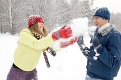 Portrait of happy couple having a fun in winter forest Stock Photos
