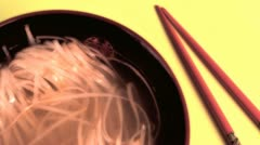 bowl of asian noodles and a pair of chopsticks - stock footage