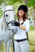 Image of happy female with purebred horse near by Stock Photos