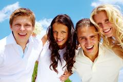 Portrait of happy girls and guys looking at camera with smiles Stock Photos