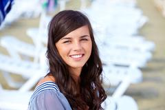 portrait of pretty young lady looking at camera - stock photo