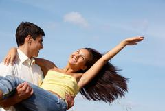 image of handsome man and beautiful girl enjoying summer together - stock photo