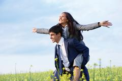 Portrait of happy business partners enjoying life and freedom in meadow Stock Photos