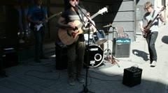 Artists play rock with guitar drum sing oldtown street Stock Footage