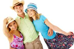 portrait of happy man and girls in hats looking at camera in isolation - stock photo
