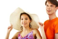 Portrait of elegant girl in hat with handsome man near by on white background Stock Photos