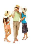 portrait of stylish man and girls in hats chatting - stock photo