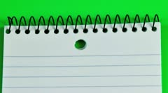 Short pencil on a lined pad of paper Stock Footage