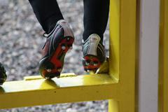Boys feet in football boots Stock Photos