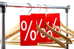 image of several wooden hangers with red labels showing discount on them - stock photo