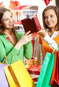 Portrait of two girls choosing gifts in the mall Stock Photos
