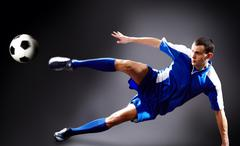 Image of soccer player doing flying kick with ball Stock Photos