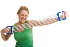 image of sporty girl doing stretching exercise with special equipment - stock photo