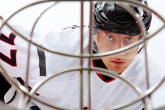 Portrait of healthy sportsman in hockey uniform during game Stock Photos
