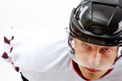 Portrait of sportsman in hockey uniform looking at camera with severe expression Stock Photos