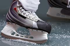 Close-up of skates on player feet during ice hockey Stock Photos