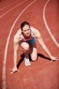 Image of sportive female ready to start running during marathon Stock Photos